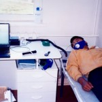 A participant in Dr. Josh Snodgrass' metabolic research in Siberia. In the photo, resting metabolic rate (RMR) is being measured using a VO2000 metabolic analyzer.